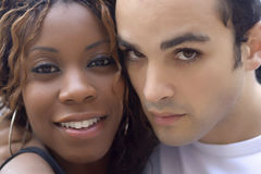 Happy Couple. Happy young interracial couple looking into camera Royalty Free Stock Photo