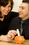 Happy couple 2. The young couple saving money Royalty Free Stock Image