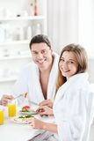 Happy couple. Young happy couple at breakfast in the kitchen Royalty Free Stock Photos