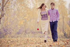 Happy couple. Low contrast image of a happy romentic young couple spending time outdoor in the autumn park stock photos
