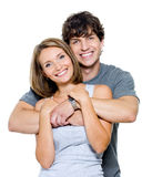 Happy couple. Portrait of young happy smiling couple - isolated on white
