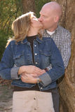 Happy Couple. Leaning on a tree for a photo Royalty Free Stock Image