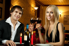 Happy couple. Romentic evening date in hotel room, or supper in restaurant, happy couple with wine glass stock photos