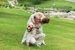Happy couple. Wedding kiss as husband and wife. Summer park Stock Photo