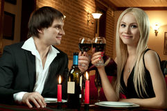 Happy couple. Romantic evening date in hotel room, or supper in restaurant, happy couple with wine glass royalty free stock image