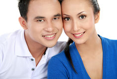 Happy couple. Portrait of a beautiful young happy couple facing each other Royalty Free Stock Photography