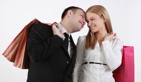 Happy couple. With shopping bags against a white background Stock Photos