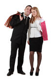 Happy couple. Happy young couple with shopping bags against a white background Royalty Free Stock Images