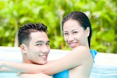 Happy couple. Enjoying together in swimming pool Royalty Free Stock Photography