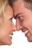 Happy couple. Profiles of beautiful blondie and brunet looking at each other and laughing Stock Photography