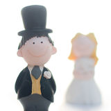 Happy couple. Bride and Groom wedding figures on white background Royalty Free Stock Photography