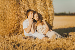 Happy couple. Image of young loving couple on wheat field Royalty Free Stock Photo