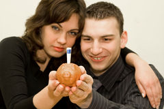 Happy couple 3. The young couple saving money Royalty Free Stock Image