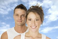 Happy couple. Over blue sky with light clouds royalty free stock photos