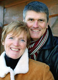 Happy Couple. Baby Boomers posing outdoors in winter clothing Stock Photography