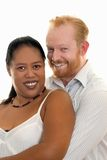 Happy Couple. Happy diversity couple smiling and looking ahead Stock Photos