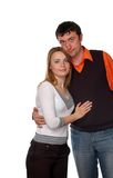 Happy couple. Pretty blonde and dark haired man standing engagement Stock Photography