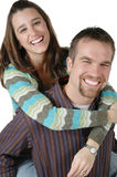 Happy Couple. Wife gets a piggy back ride from her man. Woman lovingly hugs her husband Stock Images