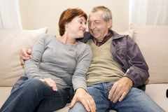 Happy couple. Happy married couple sitting on sofa Stock Photography