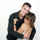 Happy couple. Studio portrait of a beautiful young couple laughing together Stock Photography