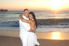 Happy Couple. Smiling attractive man and woman at the beach Stock Photos