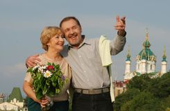 Happy couple. Middle-age couple looking on a Ukrainian church Royalty Free Stock Photography