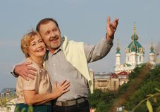 Happy couple. Middle-age couple looking on a Ukrainian church Royalty Free Stock Photos