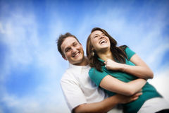 Happy Couple. A young, attractive couple plays together on a warm sunny day Stock Image