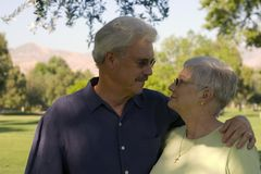 Happy couple. Happy elderly couple embrace royalty free stock images