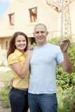 Happy couple against building new house Stock Photo