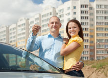 Happy couple against real estate. Outdoor portrait of happy couple against real estate royalty free stock images