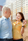 Happy couple against real estate Stock Images