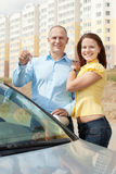 Happy couple against real estate. Outdoor portrait of happy couple against real estate royalty free stock image