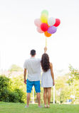 Happy couple with air balloons in city Stock Photography
