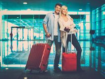 Happy couple in airport Royalty Free Stock Images