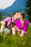 Happy couple in Alpine meadow royalty free stock photos