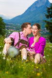Happy couple in Alpine meadow Stock Images
