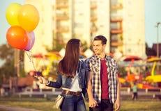 Happy couple in the amusement park Stock Image