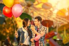 Happy couple in amusement park Stock Image