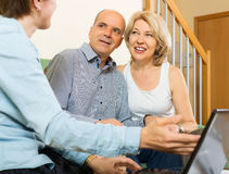 Happy couple answer questions of social worker Stock Photography