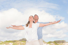 Happy couple with arms outstretched Royalty Free Stock Photography