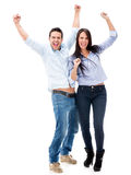 Happy couple with arms up Stock Image
