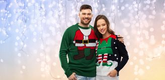 Free Happy Couple At Christmas Ugly Sweater Party Royalty Free Stock Image - 160650016
