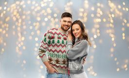 Free Happy Couple At Christmas Ugly Sweater Party Royalty Free Stock Image - 160650186