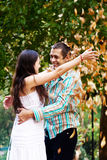 Happy couple in autumn park Stock Image