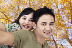 Happy couple at autumn park Royalty Free Stock Image