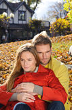 Happy Couple in Autumn Park. Fall. Young Family Having Fun Outdoors. Yellow Trees and Leaves. Laughing Man and Woman outside. Free Stock Photography