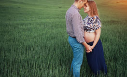 Happy couple awaiting baby. Beautiful and young parents Royalty Free Stock Images