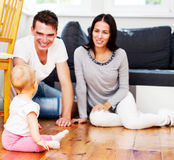 Happy couple with baby child. royalty free stock photos