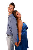 Happy couple back to back. And isolated white background Royalty Free Stock Photo